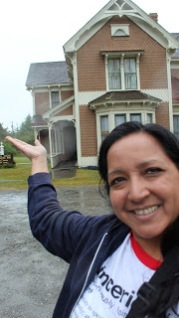 Me posing in the rain in front of the Hughes House