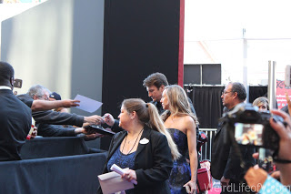 Nathan Fillion signing autographs
