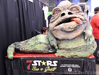 paper mache Jabba the Hutt at the 7 Stars Bar and Grill booth