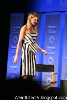 Katie Cassidy walking on stage