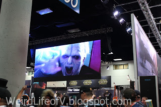 Star Wars films being shown on screens above the Star Wars booth