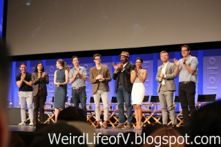 The cast and producers give a fan a standing ovation