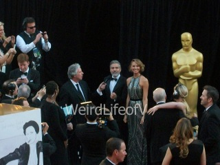 George Clooney and Stacy Kiebler being interviewed by Chris Connelly at the 2013 Academy Awards