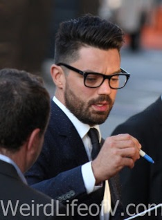 Dominic Cooper signing autographs