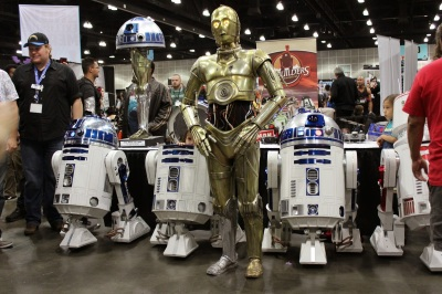 Cosplay and Droids: C3PO with R2D2 droids on the exhibition floor