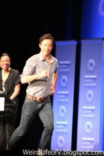 Tom Cavanaugh running across the stage