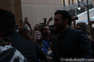 Chris Evans walking towards the Dolby Theatre