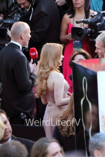 Jessica Chastain doing an interview on the red carpet for the Oscars 2013.