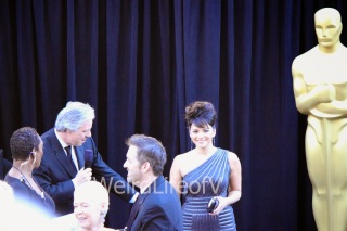 Norah Jones looking at the fans while being interviewed by Chris Connelly at the 2013 Academy Awards