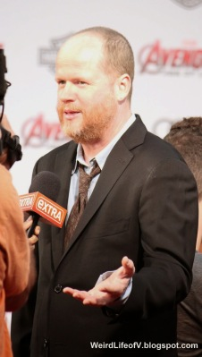 Joss Whedon being interviewed by Extra