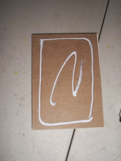 add glue to the back of the notepad