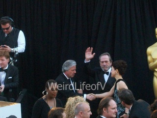 Tommy Lee Jones waving to the fans while being interviewed by Chris Connelly.