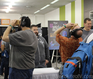 Some attendees experiencing one of the VR technologies