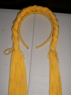Partially braided yarn attached to headband