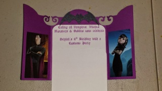 Inside of invitation features photos of Hotel Transylvania characters flanking the party information