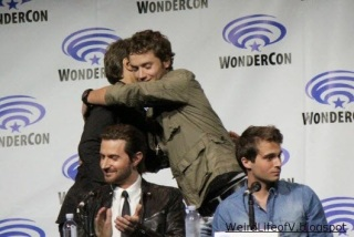 Director Steve Quale greeting Jeremy Sumpter, Richard Armitage and Max Deacon seated for the Into the Storm panel