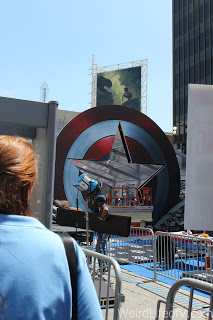 Captain America\'s shield with the star cut out for a walkway on the red carpet