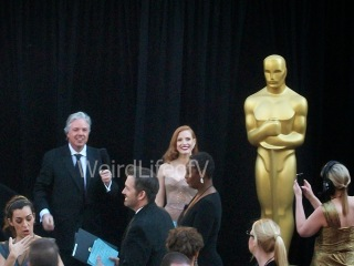 Jessica Chastain looking at the fans while being interviewed by Chris Connelly at the 2013 Academy Awards