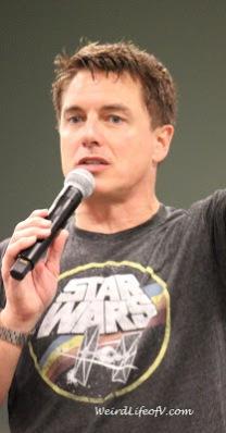 John Barrowman wearing a Star Wars shirt during his panel