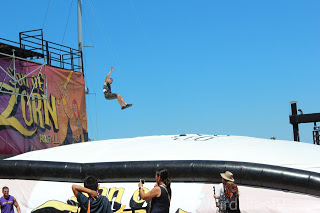 A man mid-air from his leap from the tower into the air bag