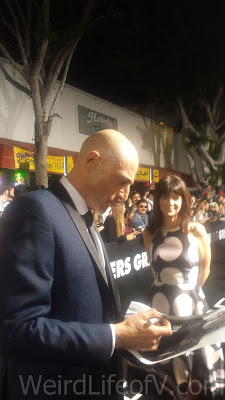 Mark Strong signing autographs