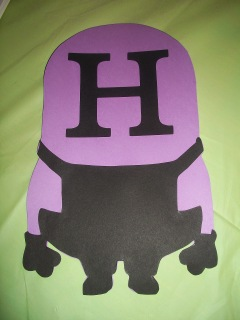 Glue pre-cut letters onto minion; here it\'s on the head