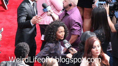 Yara Shahidi being interviewed on the red carpet - Jurassic World Premiere