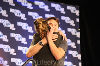 Katie Cassidy comes to say goodbye to John Barrowman during his panel