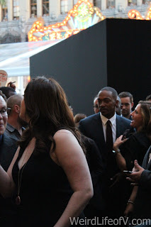 Anthony Mackie walking the red and blue carpet