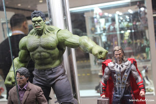 They posed the Incredible Hulk action figure punching the Thor action figure as seen in The Avengers