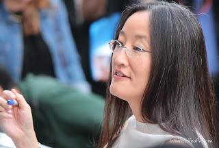 Director, Jennifer Yuh signing autographs