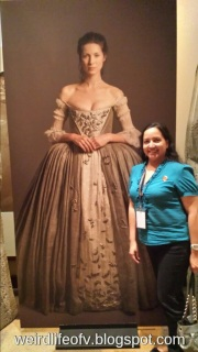 Posing with the poster of Caitriona Balfe as Claire Beauchamp-Fraser -  PaleyFest 2015 Outlander Panel