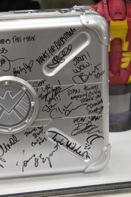 Close up of some of the signatures on the briefcase