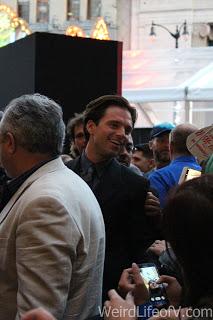 Sebastian Stan smiling at fans