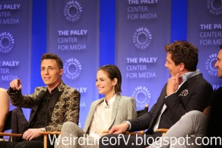 Colton Haynes pointing to the cameras after Willa Holland licked his face