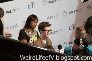 Grant Gustin doing interviews before the panel