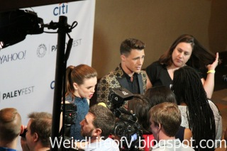 Danielle Panabaker and Colton Haynes doing press interviews before the panel