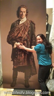 Posing with the life-size picture of Sam Heughan as Jamie Fraser - PaleyFest 2015 Outlander Panel