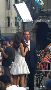 Arnold Schwarzenegger being interviewed