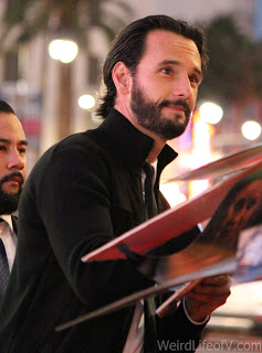 Rodrigo Santoro poses for a photo while signing autographs at the Westworld premiere in Hollywood