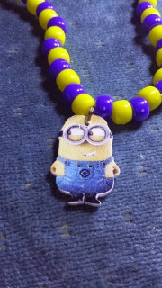 Wooden Minion button used as pendant for a necklace