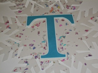 1 completed diy snowflake for the Frozen themed birthday banner