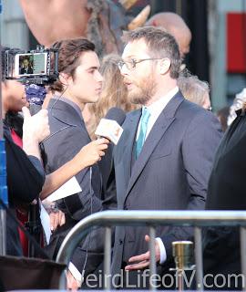 Director, Doug Jones being interviewed on the red carpet