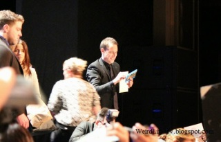 Tobias Menzies receiving a gift from fans