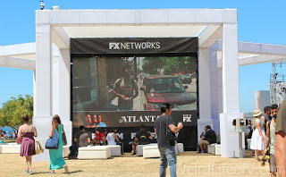 FX Networks had a seated rest spot with a large screen advertising their shows.