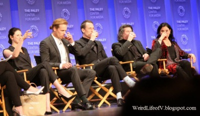 The Outlander panelists drinking whisky during a drinking game - PaleyFest 2015