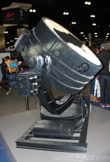 The side of the lit Batman bat signal made of Legos.