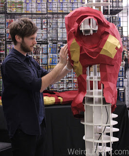 Paper Iron Man being constructed