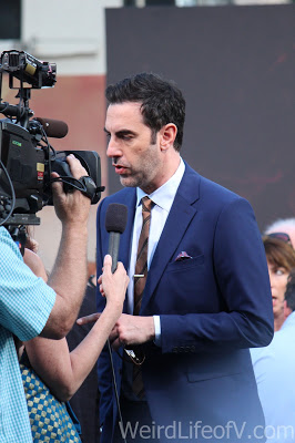 Sasha Baron Cohen being interviewed on the red carpet