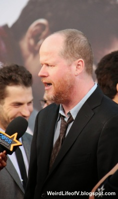 Joss Whedon being interviewed by Access Hollywood